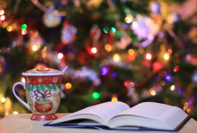 Open book by Christmas Tree