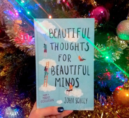 Beautiful Thoughts for Beautiful Minds beside a Christmas tree