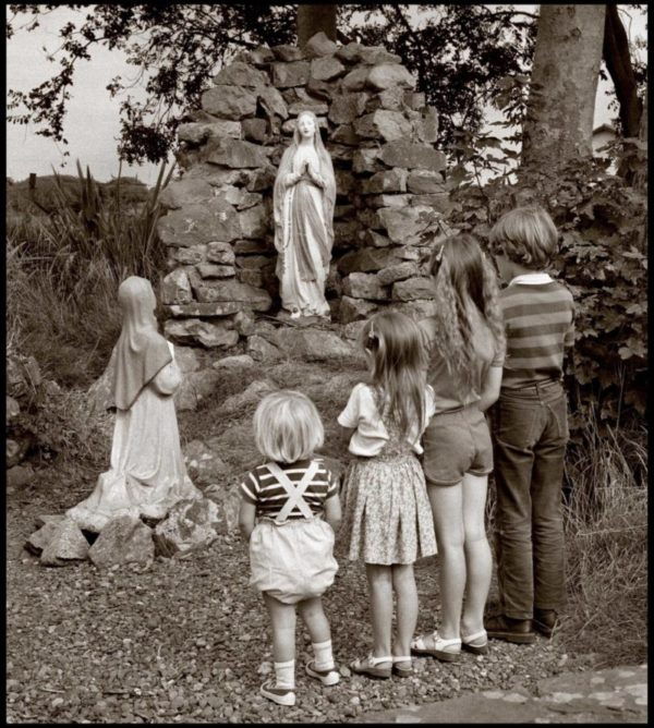 Children stand at a holy shrine, Co Waterford. 1984