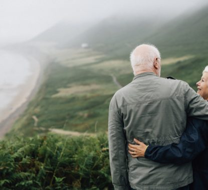 Couple enjoying view of coastal landscape