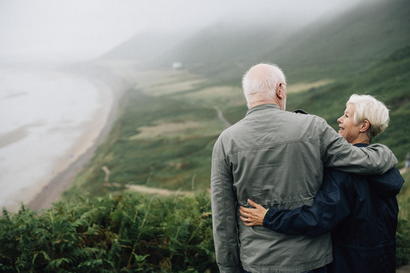 Couple enjoying view of coastal landscape