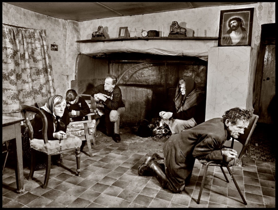 people kneeling saying the rosary at a farmhouse in Co Waterford, 1991