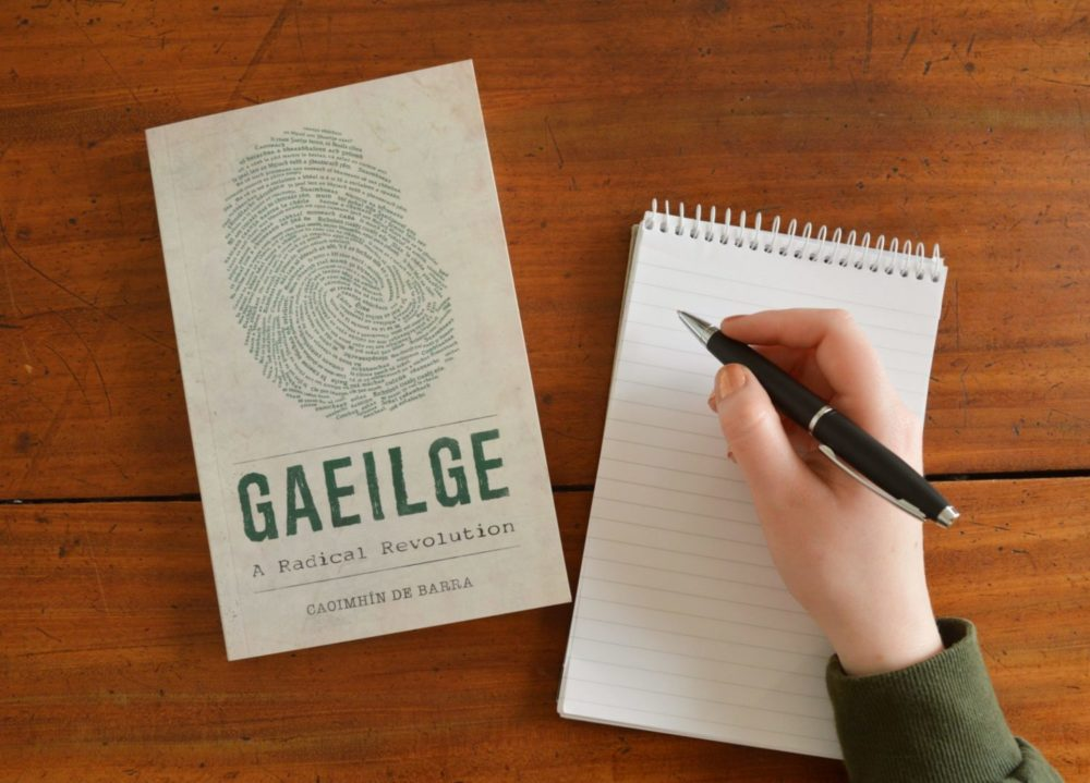 Copy of Gaeilge A Radical Revolution with a pen and notepad